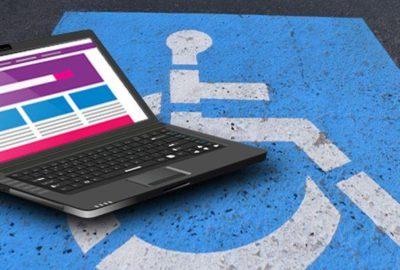 laptop over a handicapped symbol